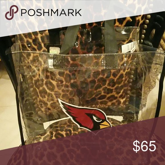 Authentic Arizona Cardinals Tote NWT Meets NFL standards for carrying into any NFL game.  Clear plastic tote with black fabric handles embossed with the AZ Cardinal.  Brand new. Arizona cardinals Bags Totes