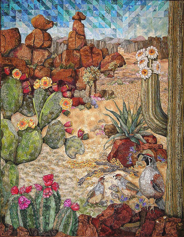 Desert art quilt by Cassandra Wiliams.  Quail, saguaro, prickly pear and agave with boulders