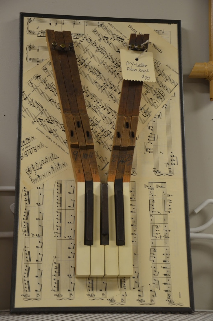 Art made from old piano parts. These are in our store! How cute!
