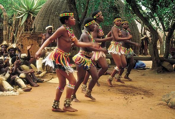 Shown in the picture above shows a South African tribe dance. The outfits and colors on these women demonstrate South Africa with green, red and yellow.