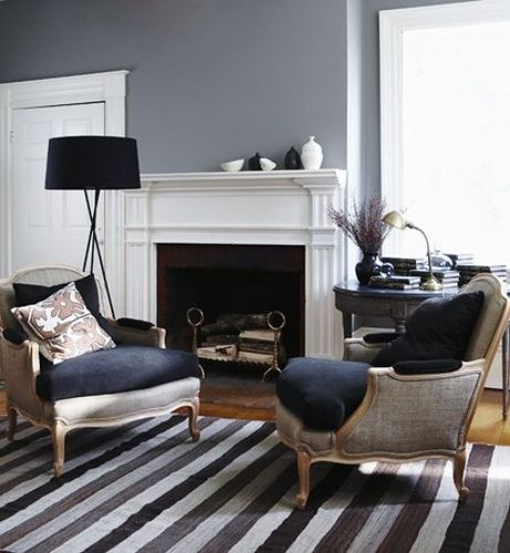 Chic Gray Living Room With Walls Paint Color Striped Rug Linen Bergere Chairs Navy Blue Velvet Cushions Black Tripod Floor Lamp