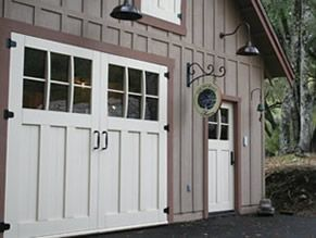 Who says garage doors have to be ugly? From Real Carriage Doors, these architecturally interesting doors  are designed to match the entry  the right.