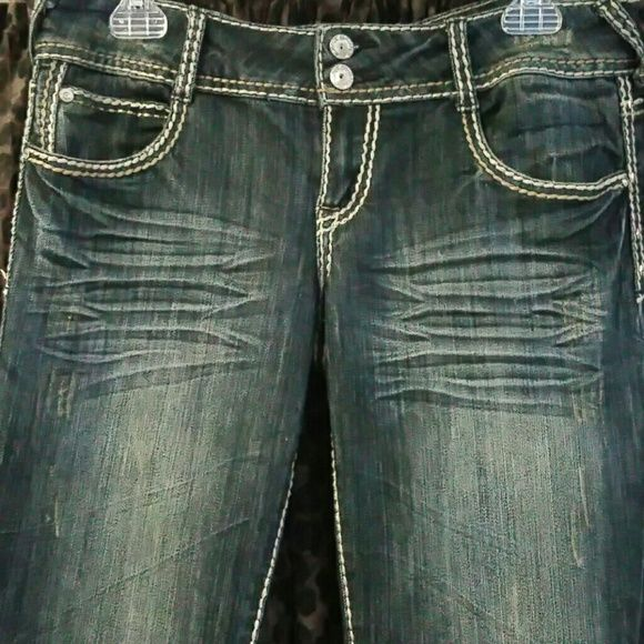 Almost Famous distressed jeans,w/bling pockets. 11 Almost Famous brand distressed skinny jeans. Size 11. Bling pockets with buttons. Decorative stitching. Very good condition. Almost Famous Jeans Straight Leg
