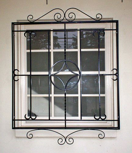 Decorative security window bars iron blog for Fancy window design