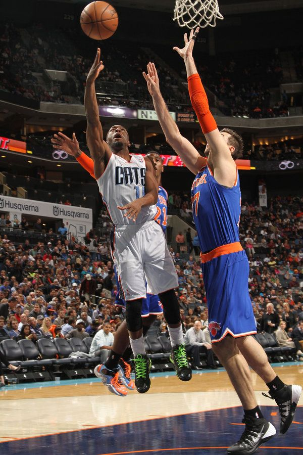 CHARLOTTE, NC - NOVEMBER 8: Kemba Walker #15 of the Charlotte Bobcats shoots against Andrea Bargnani #77 of the New York Knicks at the Time Warner Cable Arena on November 8, 2013 in Charlotte, North Carolina. NOTE TO USER: User expressly acknowledges and agrees that, by downloading and or using this photograph, User is consenting to the terms and conditions of the Getty Images License Agreement. Mandatory Copyright Notice: Copyright 2013 NBAE (Photo by Brock Williams-Smith/NBAE via Getty…