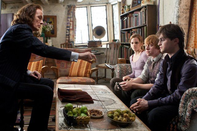 Minister Rufus Scrimgeour (Bill Nighy) presents items to Dumbledore's benefactors in Harry Potter and the Deathly Hallows: Part 1 (2009 photo by Jaap Buitendijk)