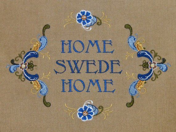 """Home Swede Home"" embroidery in blue."