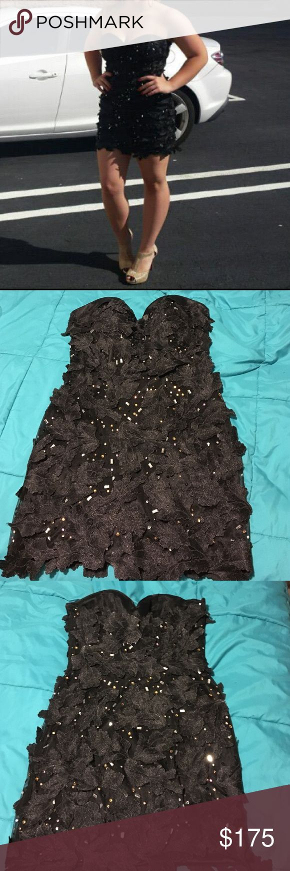 Homecoming dress! Strapless, tight fitting. This dress is extremely cute and has a lot of detailing to make it unique and formal! Dresses Strapless