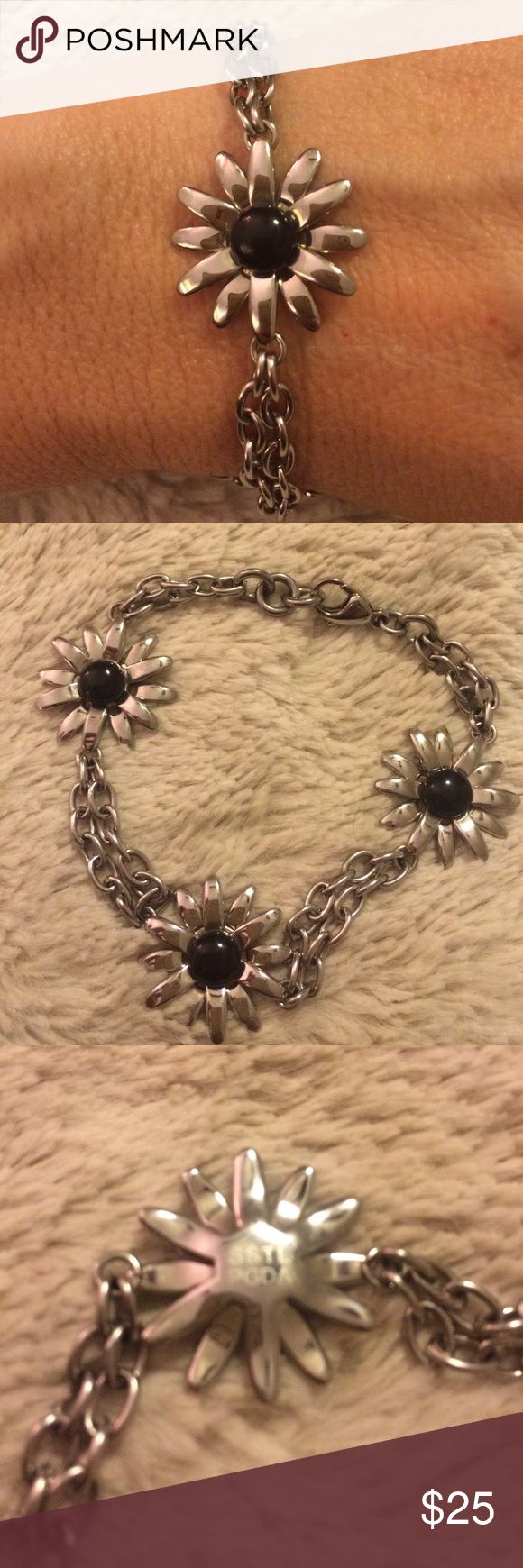 Stainless Steel Piercing Pagoda Bracelet Stainless Steel bracelet with 3 daisies-black in center. Double strand. Measures 7.5 inches. Lobster clasp Piercing Pagoda  Jewelry Bracelets