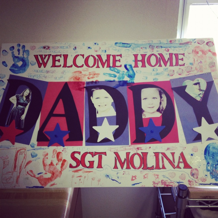 Welcome home from deployment! Love this sign with the hands! Def have to let little man make one for daddy :)