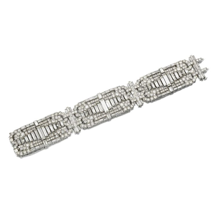 DIAMOND BRACELET, 1930s Designed as a series of articulated open work plaques, set with circular-cut, baguette and demi-lune shaped diamonds, length approximately 185mm, one diamond deficient.