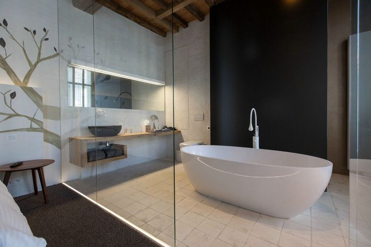 Image from http://www.trendir.com/house-design/assets_c/2013/11/modern-rustic-inspiration-belgium-features-exposed-ceilings-11-light-ensuite-thumb-970xauto-25075.jpg.