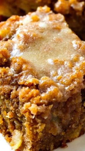 Glazed Apple Crumb Cake ~ Moist, buttery cinnamon apple crumb cake piled high with a sweet cinnamon crumb topping and a warm vanilla glaze drizzled over top.