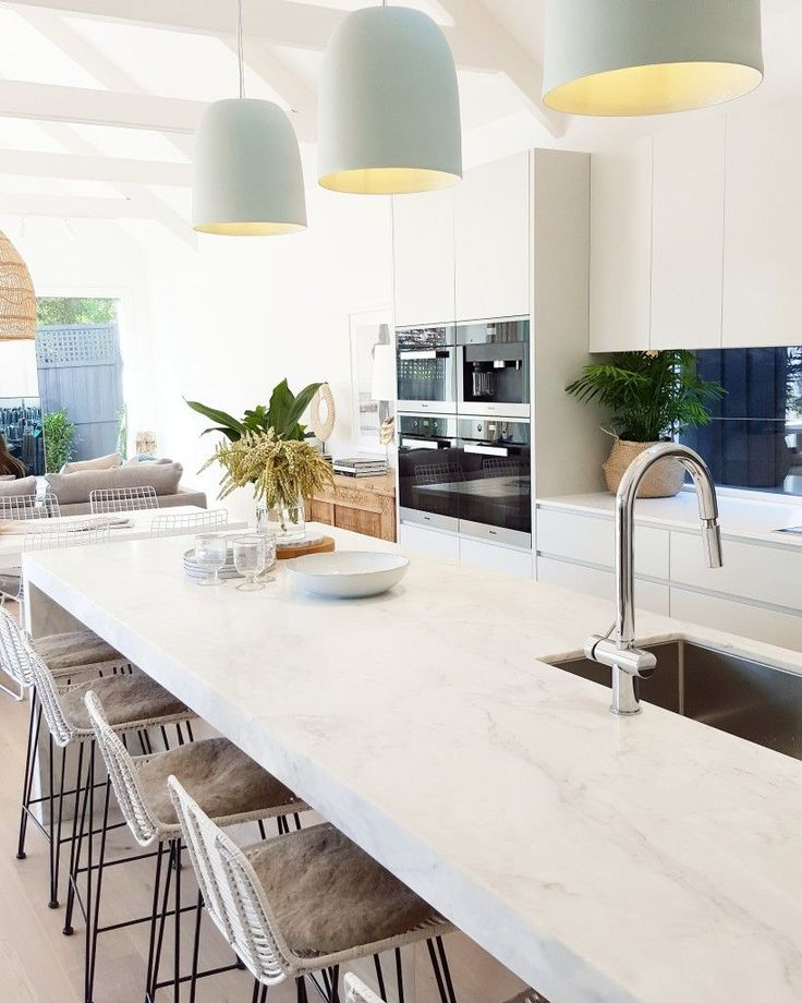 baby blue pendant lights, marble island, entertaining kitchen, white bright, light, home, beams, bar stools