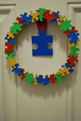 Austim Awareness DIY wreath. Spray paint or color in the back of puzzle pieces & hot glue to foam wreath. Let us find answers together. G;)