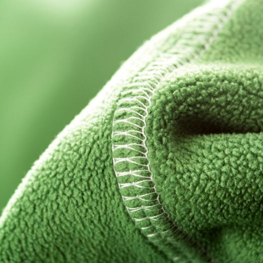 A tip to keep air-contaminating dust bunnies at bay: Clean with fleece instead of disposable cloths. The fabric attracts dust and can be washed and reused, to save you money!