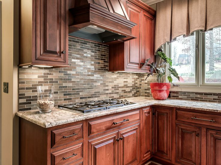 Cherry cabinet kitchen with great hooded vent