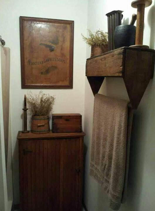 Country decor - a vintage tool box hung upside down becomes a pretty shelf and towel bar.