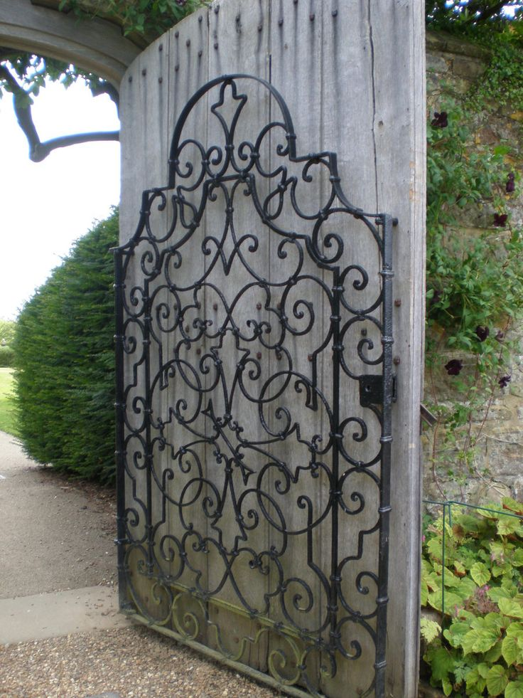 Garden Gate... Looks Like Iron Gate Attached To Privacy Fence. Interesting.