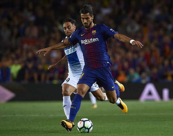 Andre Gomes (R) of Barcelona competes for the ball with Sergio Garcia of Espanyol during the La Liga match between Barcelona and Espanyol at Camp Nou on September 9, 2017 in Barcelona.