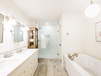 Luxury duplex with spa-like Master Ensuite Bathroom. Two undermount sinks set in quartz counters, custom white vanity, 10mm glass shower enclosure, freestanding tub. The Edge Model by Kimberley Homes in Salisbury Mansions, Sherwood Park  #buildwithkimberley #kimberleyhomes #familyroom #newhome #newhomeconstruction #sherwoodpark #yeghomes #yegre #yegrealestate #townhome  #ensuite #bathroom #bathroomdesign #bathroomdecor #bathroomideas #bathroomremodel #freestandingtub #freestandingbath