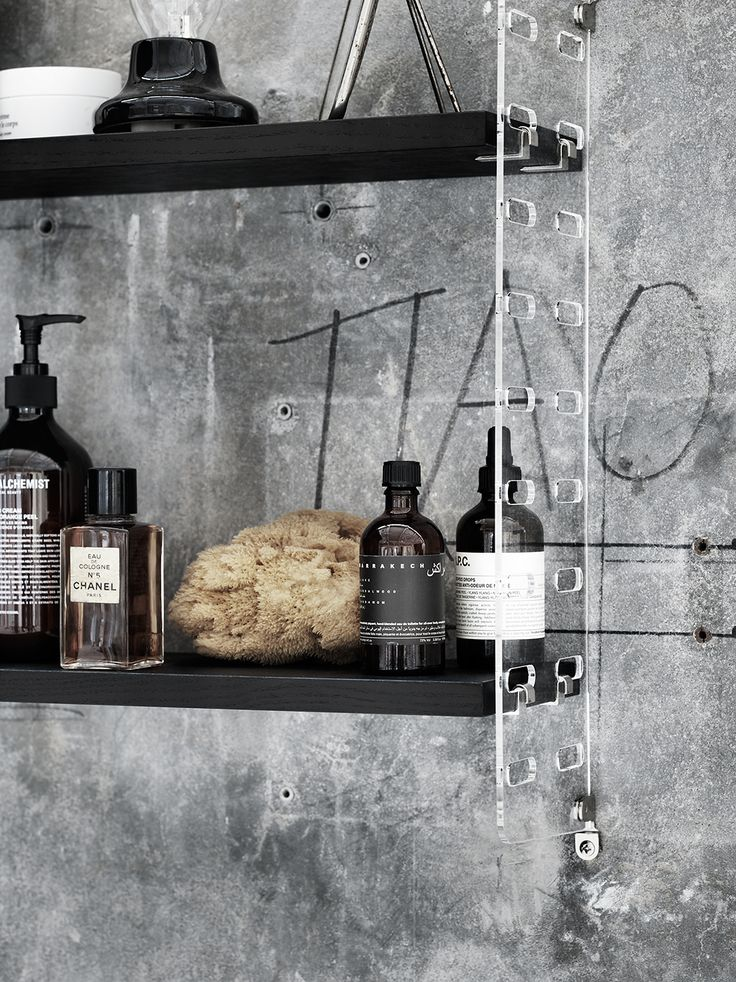 String_2016_Lotta_Agaton concrete bathroom with lovely trendy bottles and a natural sponge