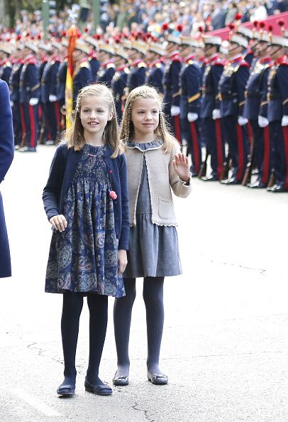 (L-R) Princess Leonor of Spain and Infanta Sofia of Spain attend the National Day Military Parade 2015 on October 12, 2015 in Madrid, Spain.