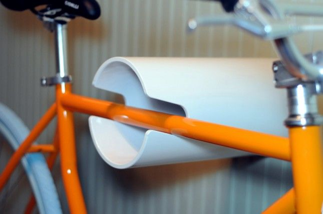White Tube Rack ($65): On the more avant garde side of things, we have this unusual tube shaped rack. We're not quite sure how this mounts onto your wall but we're digging the minimalism [https://www.etsy.com/listing/116102565/wall-bike-rack-hanging-display]