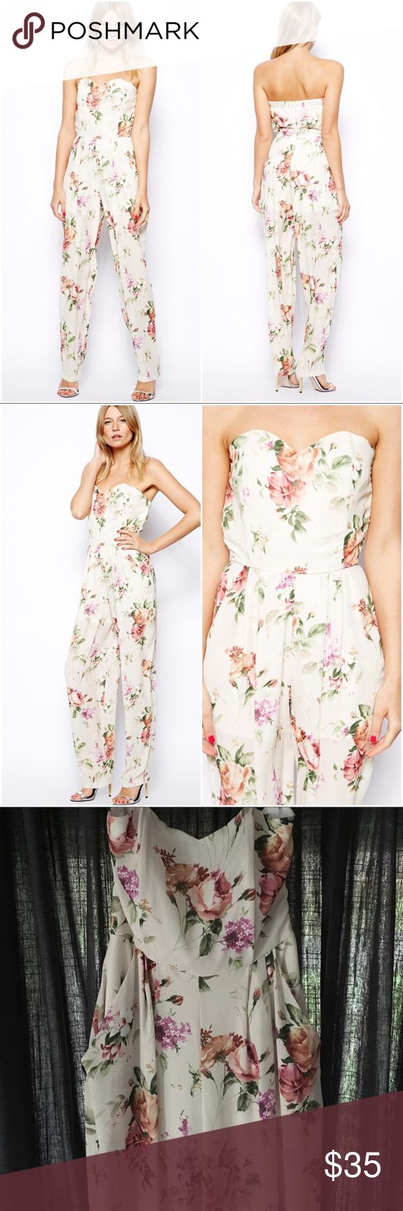 • ASOS LOVE • FLORAL STRAPLESS BANDEAU JUMPSUIT • Delicate taupe and lavender blossoms play an edgier part in this forward piece. Boning within the sweetheart bust provide shape and support. Pockets at the hips perfect for stashing your lipstick for quick touch ups. Light and airy fabrication. Bodice is lined/Bottom partially lined. Two small holes by inner hanger straps (see last photo). These are not visible when worn and do not affect the functionality of the garment. Length is approx…