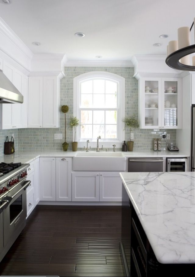 so pretty... love the contrast of the dark floors and the white cabinets!