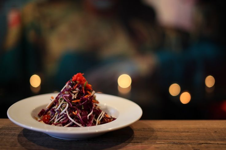 VIETNAMESE CHICKEN SALAD    Chicken from the A La Carte Menu    Succulent beef of chicken char-grilled, sliced and tossed with red cabbage, carrot, snow peas, tomato, bean sprout and fresh herbs before being misted with a chilli lime infusion