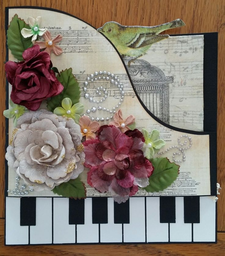 Challenge 26 - Piano card - Baby grand piano cut on the Cameo. I attached a serviette with mod podge on the inside of the card which gives lovely texture. The flowers are various Prima flowers and Say it in Crystals