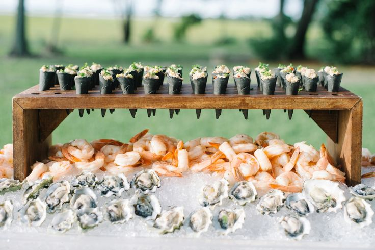 A raw bar for Kenly & Steve's Lowndes Grove Plantation wedding | Charleston, South Carolina | Photo by Aaron and Jillian