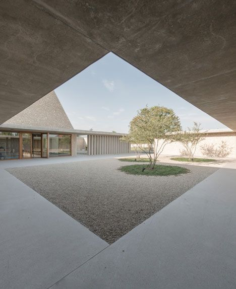 Stone funeral chapel in a small German town by Bayer & Strobel Architekten