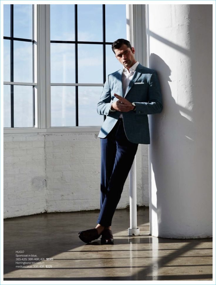 Christopher Campbell outfits Sean O'Pry in a HUGO by Hugo Boss blue sportcoat $645 and herringbone trousers $225.