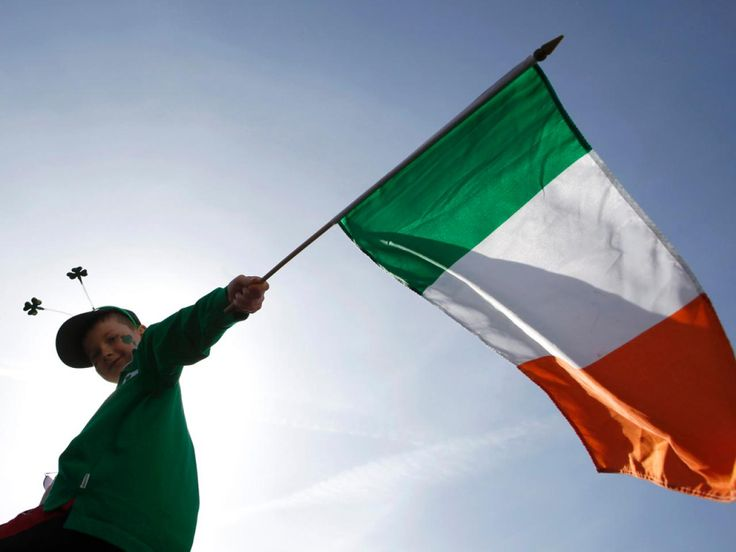 A boy holds a Republic of Ireland flag during a St Patrick's day march in central London.