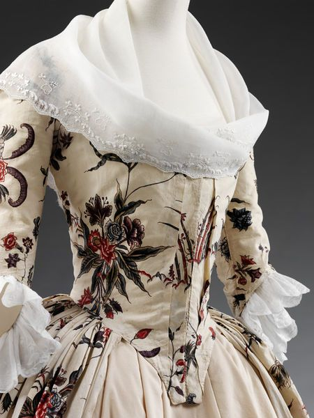 Fichu scarf of embroidered muslin, England, 1730-1769. A fichu is a scarf-like garment that was draped over the shoulders and tucked into the bodice to fill in a low neckline. It originated in England.