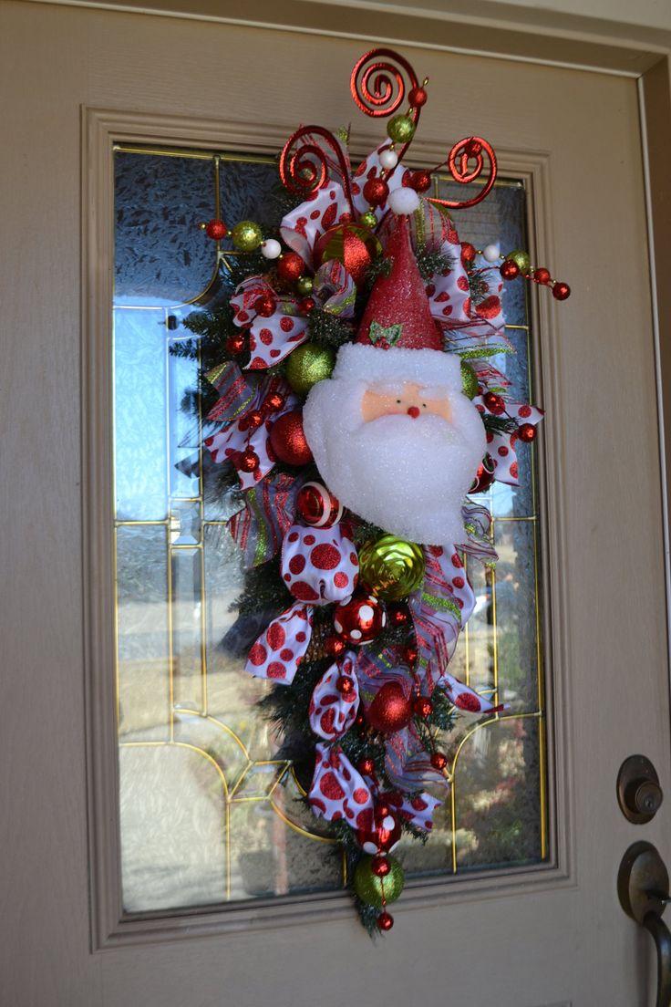 Whimsical Santa Door Swag. $90.00, via Etsy.