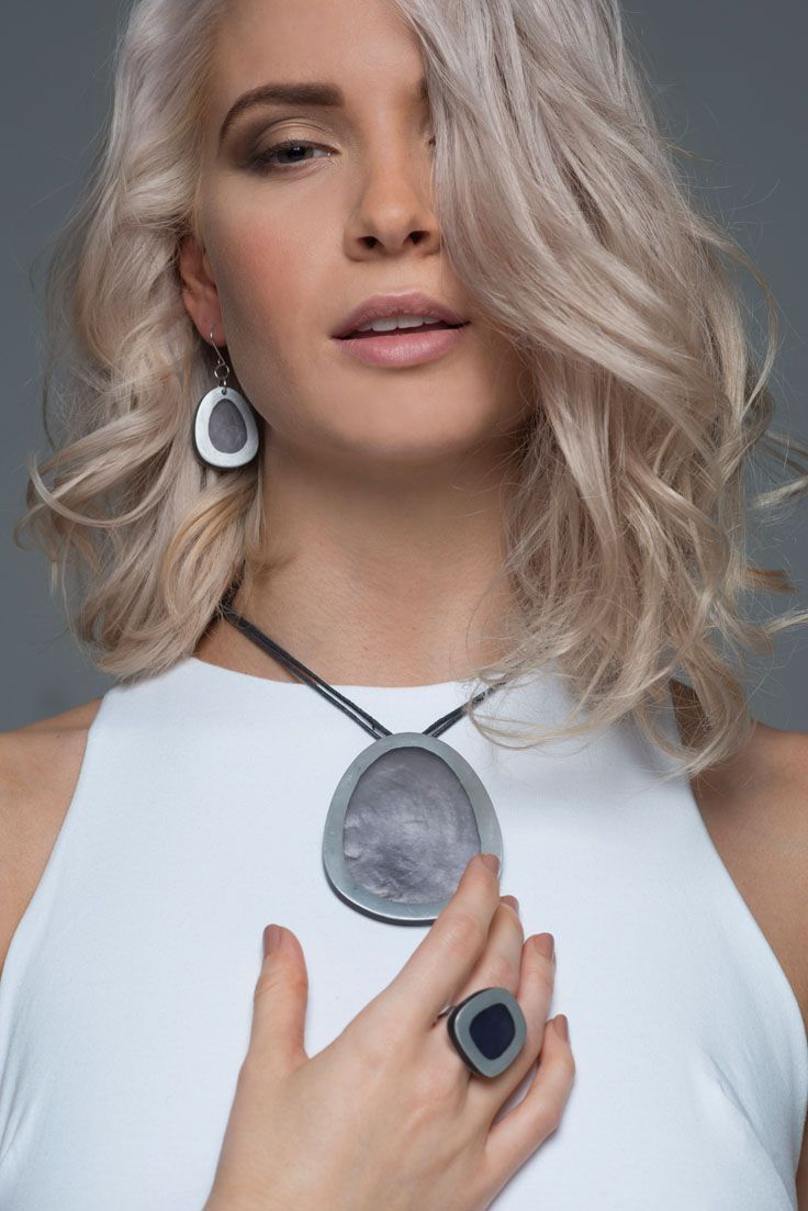 Obelia necklace - Ash. Dramatic, and eye catching our Obelia necklace is simply stunning - perfect for any special occasion. It comes in two colours Ash and Blue, and looks amazing worn with neutral block colours. A large egg shaped metal and resin pendant drop elegantly from an adjustable cord. Teamed with our Riverstone earrings and rings, it is the perfect accessory for making a statement.