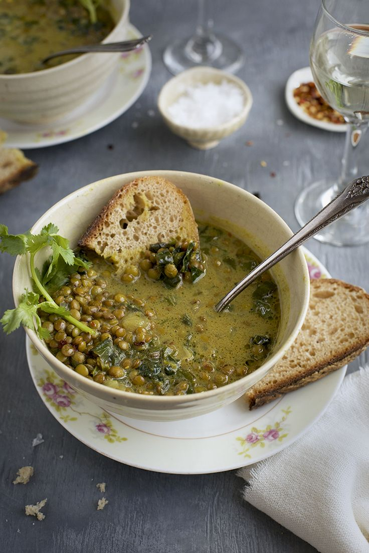 """This Coconut Basil French Green Lentil Soup is a """"warming of the soul"""" kind of soup, with its subtle flavors of Indian spice. The fresh basil, cilantro, kale and lime give it a nice fresh quality while the lentils satisfy your hunger. This is a versatile soup that you can leave as it is or …"""