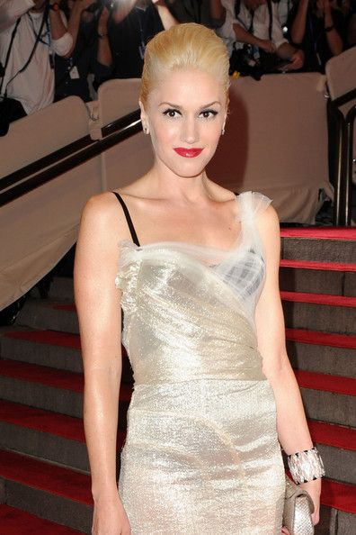 only she could pull off a black bra under a sheer white dress