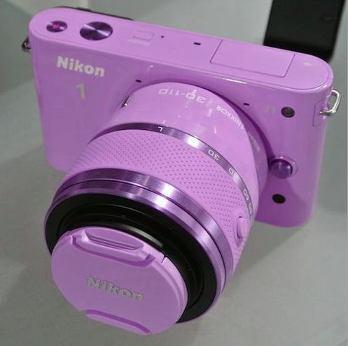 Purple nikon camera! I know its stupid but I love photography, I want to make a career out of it one day, work for magazines and all that
