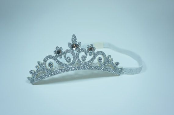 Check out this item in my Etsy shop https://www.etsy.com/listing/182124132/princess-tiara-elastic-baby-hair-band