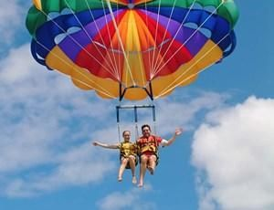 Soar above paradise. Parasailing on  #HamiltonIsland