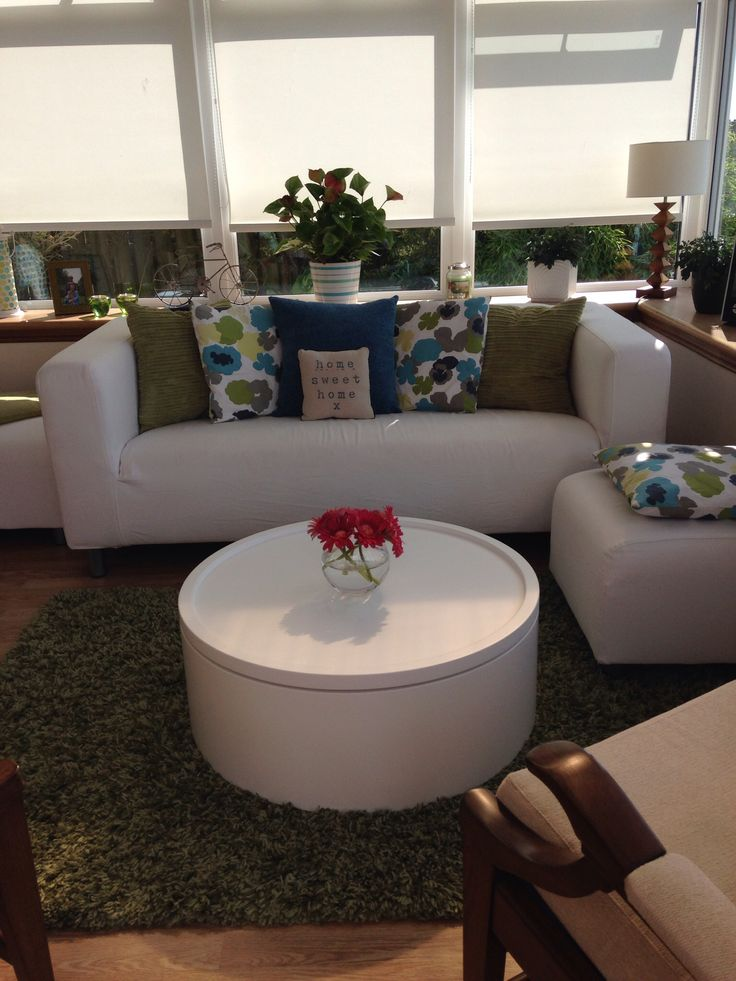 Conservatory new colour scheme for summer, cream, olive and turquoise. IKEA sofa and footstools, Dwell coffee table.