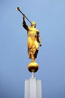 Angel Moroni - Bern Temple, Switzerland. Holds nothing but a trumpet. Upon the highest spire of the majority of the LDS Temples of the world, an angel stands with a trumpet in hand declaring the everlasting gospel, that it has been restored. It is a message to very nation, kindred, tongue and people. Each Moroni symbolizes the angel of the Restoration as seen in vision by John the Revelator.