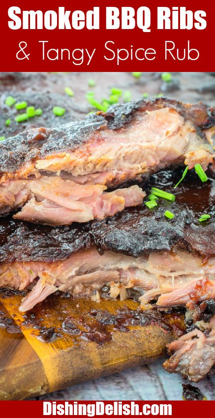 #GetGrillingAmerica #ad Smoked BBQ Ribs & Tangy Spice Rub is the perfect recipe to pull out at your next big BBQ. It's tender pork ribs rubbed with seasoning and slowly smoked to perfection until they're practically falling off the bone. Then you smother them in your favorite BBQ sauce for a finger-licking meal you'll crave!