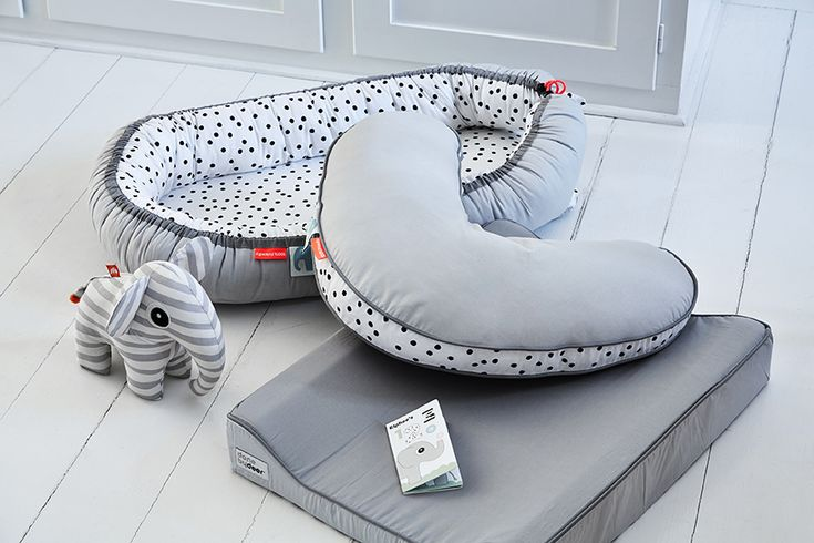 Stylish Nursery Pillow and Cozy Nest with Happy Dots cuddling the baby. The grey trend is completed with the grey Changing Pad from the Candyfloss collection. #donebydeer #nursery #happydots #babynest