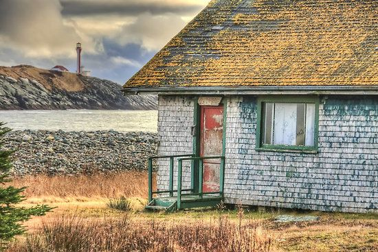 The old school house at False Harbour, with the Cape Forchu Lighthouse in the background