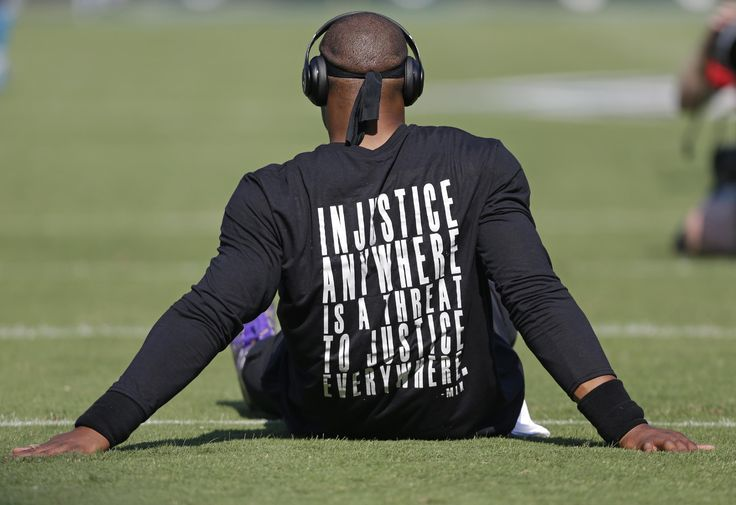 The Latest: Newton wears T-shirt with MLK quote